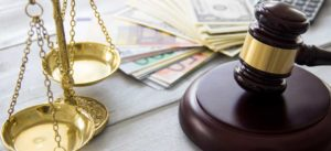 Currency on table with gavel chapter 11 bankruptcy