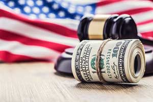 Money and gavel with american flag background