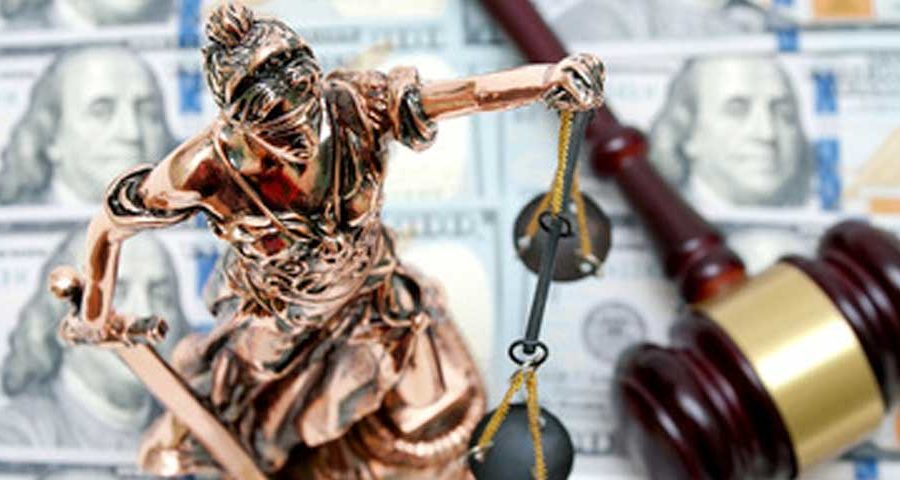 Gavel and statue of justice on money