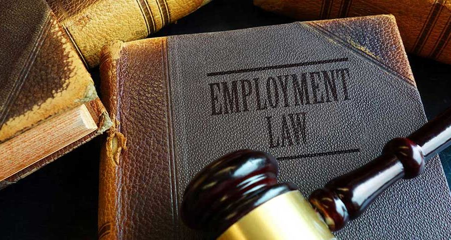 Employment law book with details of the EEOC