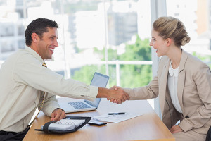 small business owner shaking hands with a contractor