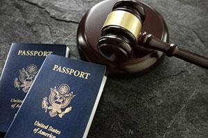 Gavel next to passports acquired by h-1b visa