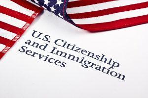USCIS logo, who issues H-1B visa RFEs