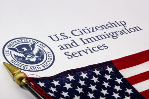logo of the USCIS, who issues L-1A visas