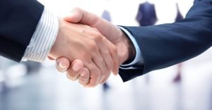 firm handshake between a debtor and a buyer who is purchasing assets out of bankruptcy