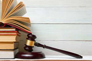 Gavel on top of statute of limitations law books