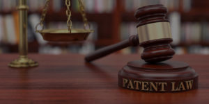 a gavel labeled patent law on it that symbolizes patents and trademark litigation