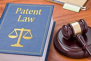 a patent law book next to a gavel which are both owned by a litigation and dispute resolution attorney with experience with patents