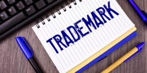 A notebook with the word trademark written in blue ink