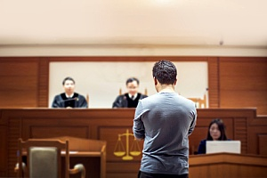 a man being tried in a foreign court while attempting to have his case domesticated in the US
