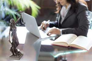 trademark attorney looking through trademark infringement documents