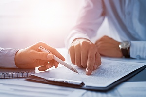 a person discussing a non competition agreement with an attorney