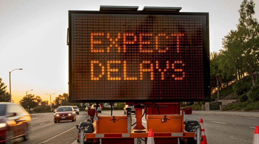Construction delay on a sign showing expected delays