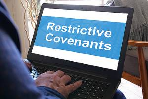 Restrictive covenant on laptop screen