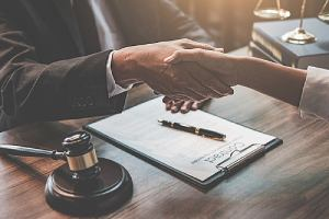 Chapter 11 Bankruptcy lawyer shakes hand with client