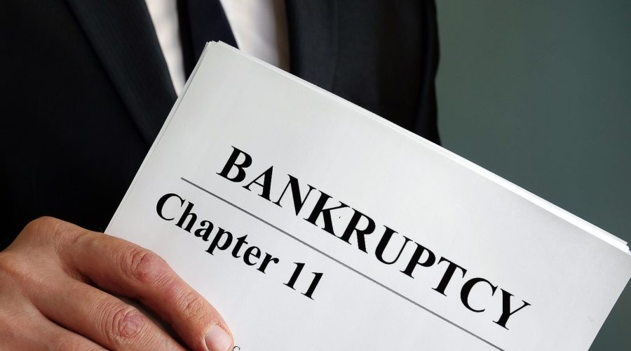 Lawyer holds Chapter 11 Bankruptcy agreement documents