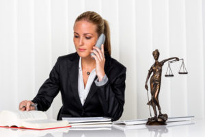 attorney talks to the client over the phone about hardship clause laws