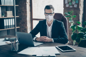lawyer wears mask as a precaution before meeting client of a force majeure case