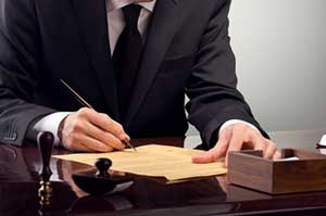 an Atlanta contract law attorney signing documents