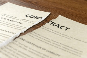 a breach of contract laying on the ground after being broken