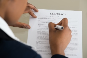 person signing a contact before it was a breach of contract