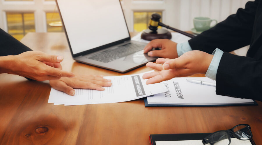 bankruptcy attorney showing client papers