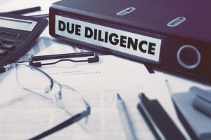 book that has due diligence checklist sitting on counter