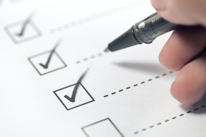 Due Diligence Checklist checking things off of a list
