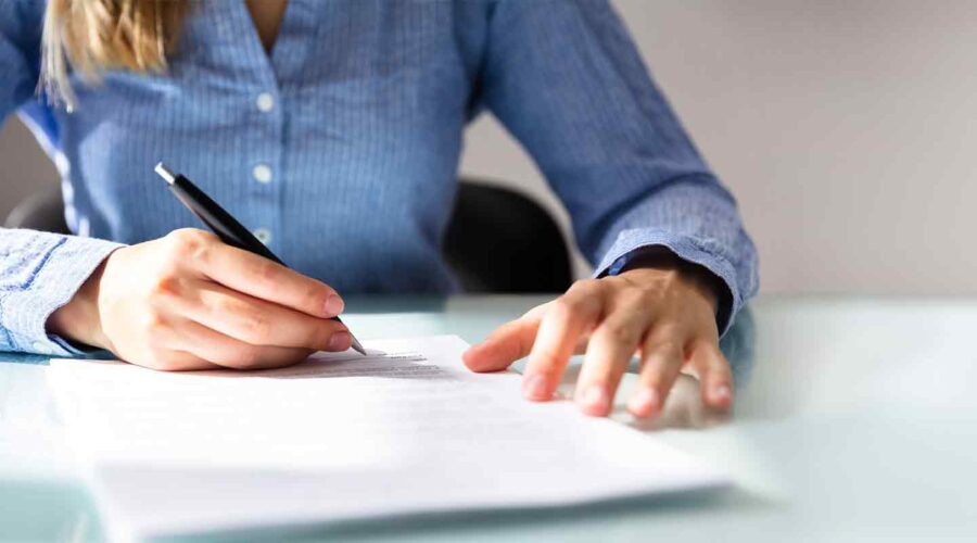 women signing papers for Contract Law